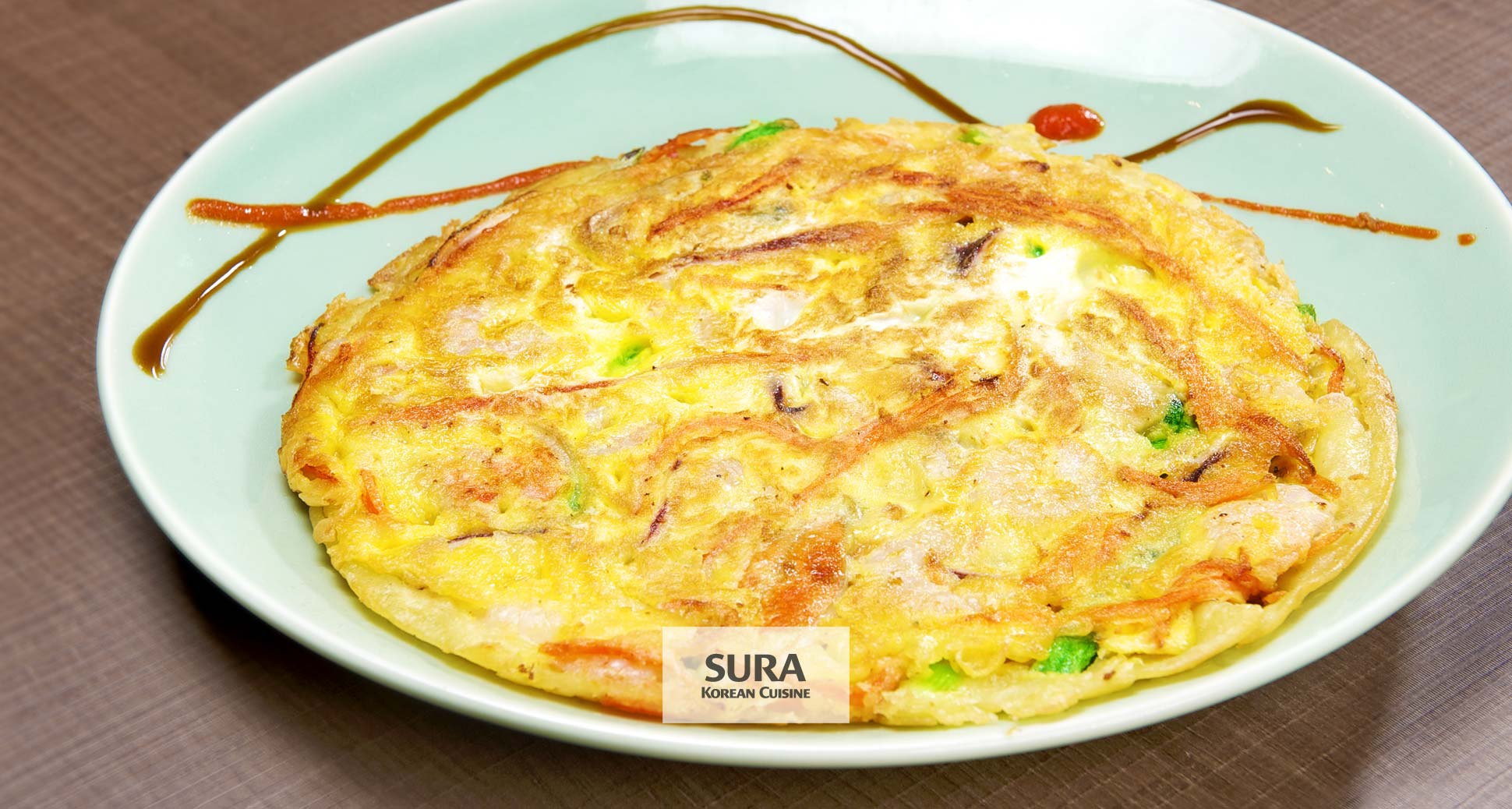 Why do koreans love to enjoy korean style pancakes and drink korean rice wine on a rainy day?